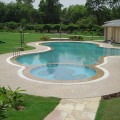 piscina pool surround in Autumn brown cobbles 1 slide